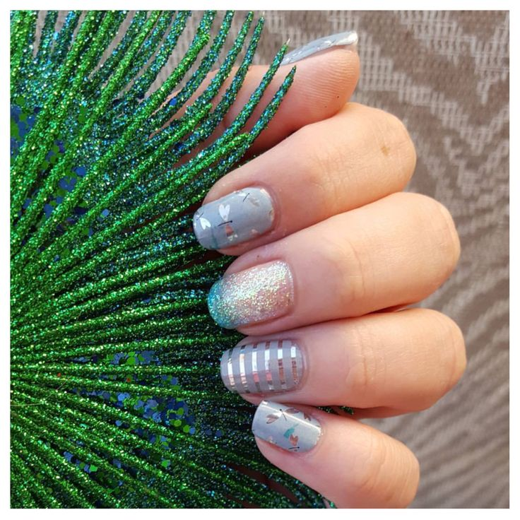 Glistening dragonflies adorn, 'Fly Away' creating truly mystical nail art on this Jamberry wrap.