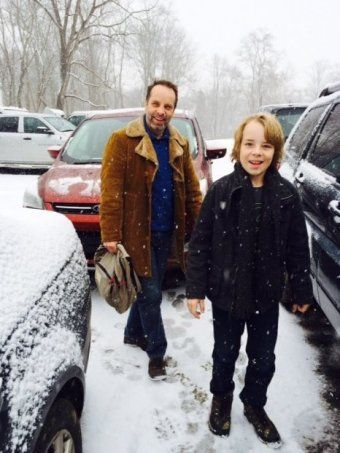 Jamie Oxenbould in snow with son Ed