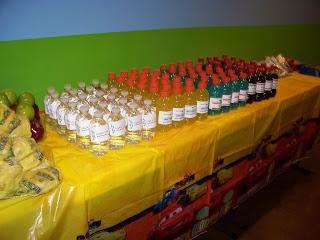 "CARS party: Our ""radiator fluid"" (water), ""antifreeze"" (green gatorade), ""wiper fluid"" (blue gatorade) and ""Rusteeze"" Motor Oil (coca-cola)."