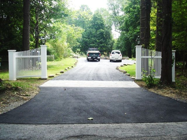 White wood picket radius fence sections for driveway