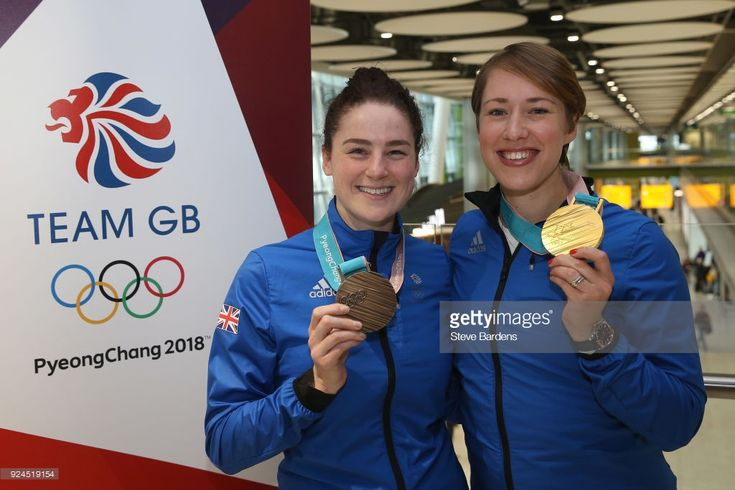 Laura Deas and Lizzy Yarnold of Great Britain pose with their skeleton bronze and gold medals during the Team GB Homecoming from the Winter Olympics at Heathrow Airport on February 26, 2018 in London, England.