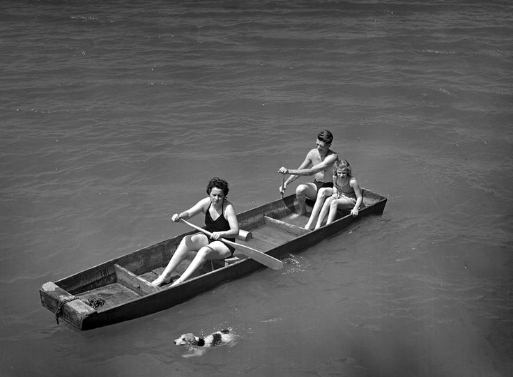 Sheffield, Alabama (Tennessee Valley Authority). Kenneth C. Hall, his wife and daughter rowing on the Tennessee River. Photograph by Arthur Rothstein for the Tennessee Valley Authority, June 1942.
