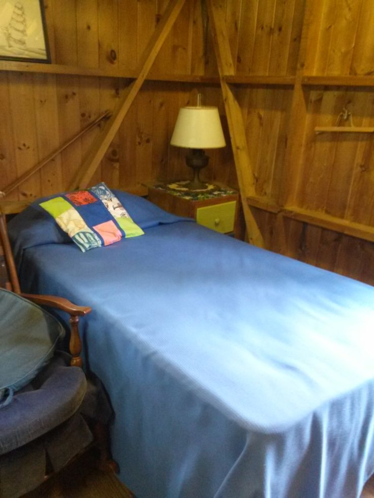 Photo taken 2014: One of the twin bunk room beds. The twin beds are made up of a mattress on plywood board which is on platform with legs and casters. Circa 1947. Taken in the Nickerson North Beach Camp. #northbeach, #nickerson, #camp, #beachcamp, #1940s, #atwoodhouse, #chathamhistoricalsociety, #chatham, #capecod