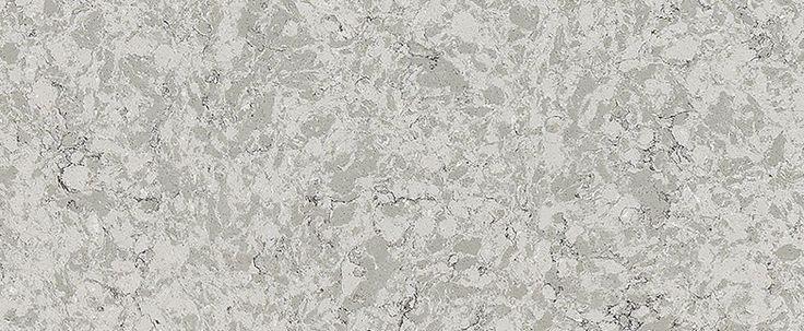 Via Augusta es un diseño de cuarzo en tono gris cálido mezclado con vetas en tonalidades de carbón con discretos reflejos en color blanco y sutil movimiento .