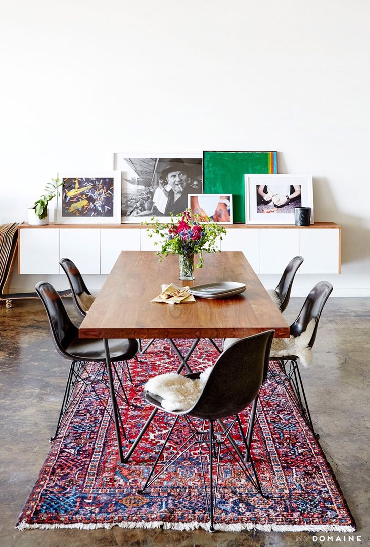 Onderstel Tafel: An Industrial And Modern Dining Space With Leaning  Artwork, Persian Rug, And Wood Dining Table