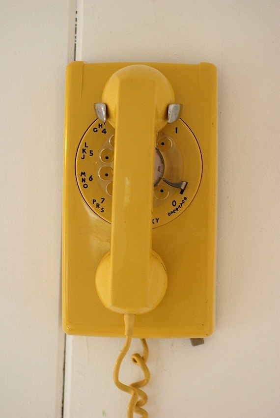yellow telephone  Just like the one my parent's had.