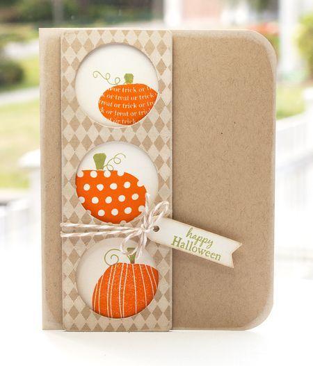 peek-a-boo pumpkins...pumpkins peek out of circles cut in patterned column...cute a clean design...