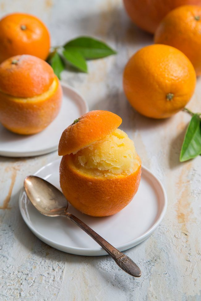 Orange Sorbet served in real oranges. A classic, scrumptious warm weather treat. #citrus #desserts