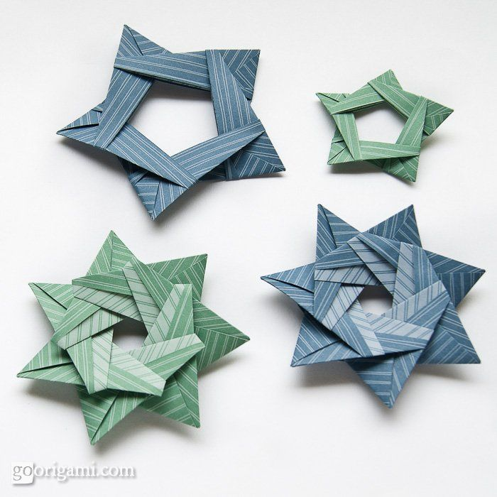 5, 7 and 13-Pointed modular origami stars folded from silver rectangles. Photos and description.