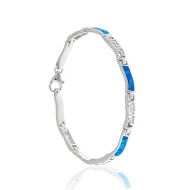 A sterling silver bracelet featuring traditional Greek Key or Meander links joined with bright blue opal gems hand carved in a wavy shape. Symbol or eternity and unity in ancient Greece, this is a modern sterling silver bracelet with a classical twist. The polished silver makes an impressive contrast with the blue opal's vibrant colour. Have fun by creating multiple looks with one piece of jewellery.