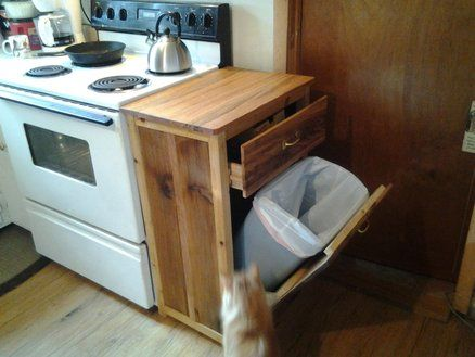 Trash can holder/protector for kitchen. Built in trash can with cuttting board surface. No instructions included, just love the idea.