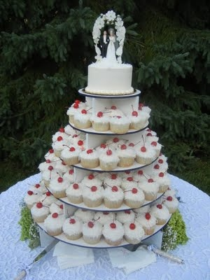 The cupcake stand and vintage cake topper