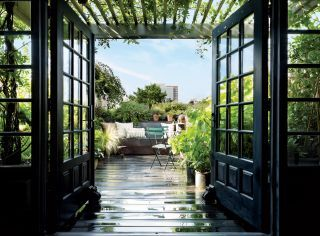 Black framed windows and glass french doors - architectural digest