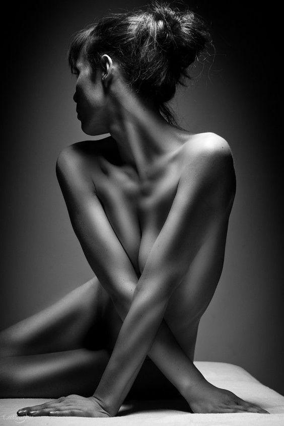 Naked women touching black and white