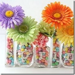 i like these center pieces if we did fake flowers in the party colors and then filled with skittles or some kind of bright candy