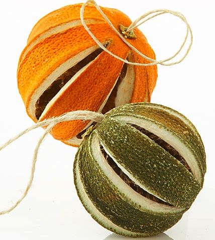 smell good ornament; the link is garbage, but a great idea! if you slice wedges out of a fresh orange(or lemon, etc.), you can get the insides out and potpurri in, then once the peel dries out it'll all be locked in there, I love it!