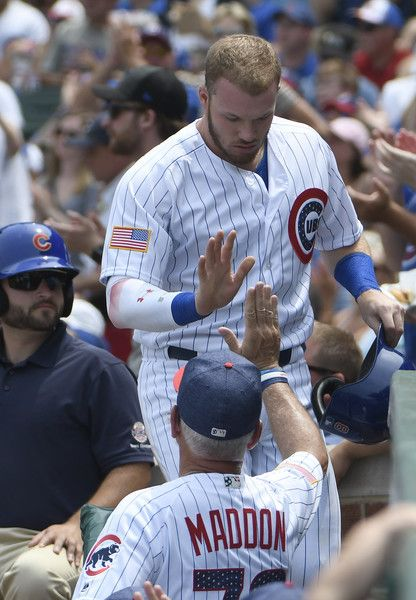 Joe Maddon Photos Photos - Ian Happ #8 of the Chicago Cubs is greeted by Joe Maddon #70 after scoring against the Tampa Bay Rays during the second inning on July 4, 2017 at Wrigley Field  in Chicago, Illinois. - Tampa Bay Rays v Chicago Cubs