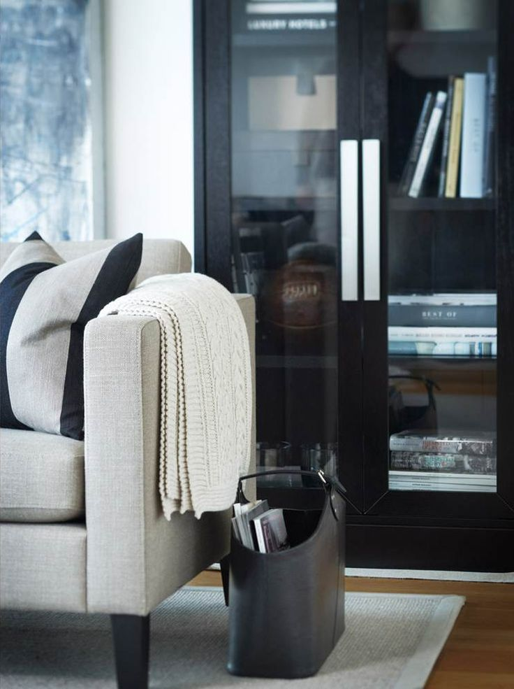 glass doors on black bookcase and white comtemporary occasional armchair - lovely office styling