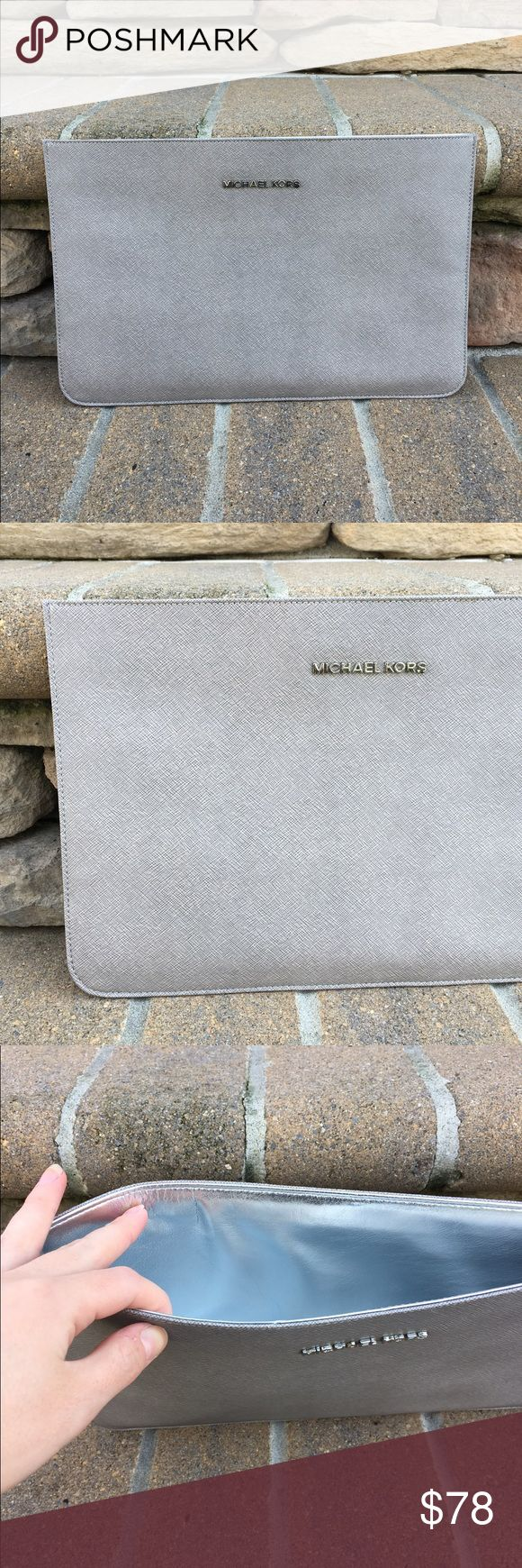 ✨Michael Kors grey clutch NWOT, never been used. Large clutch that is perfect for special events when you want a more sophisticated and mature look. The size is best seen in the last picture, but the dimensions are 12.5x8. The color is a grey and the inside is silver, very classy piece. This clutch will last you forever, it will never go out of style! Michael Kors Bags Clutches & Wristlets