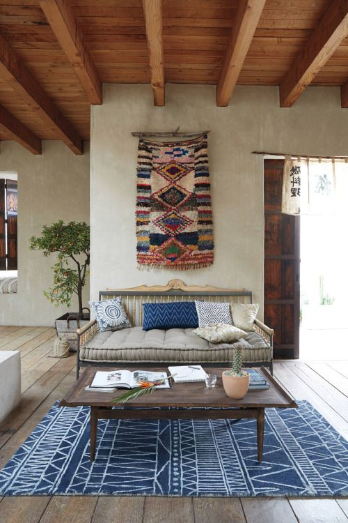 So many exotic textiles in this space. And that rug on the wall . Wonder where I can find that indigo rug.