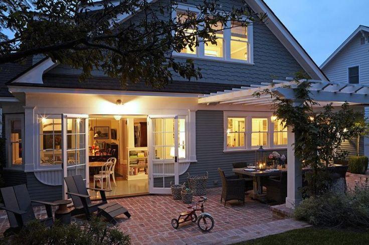 Patio idea - white pergola, brick paving