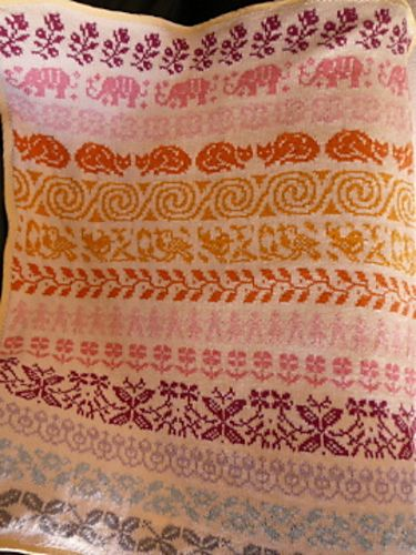 Ravelry: Project Gallery for Baby Blanket Latvian Garden pattern by The Needle Lady - note the elephants and cats and flowers (a fairisle masterclass)