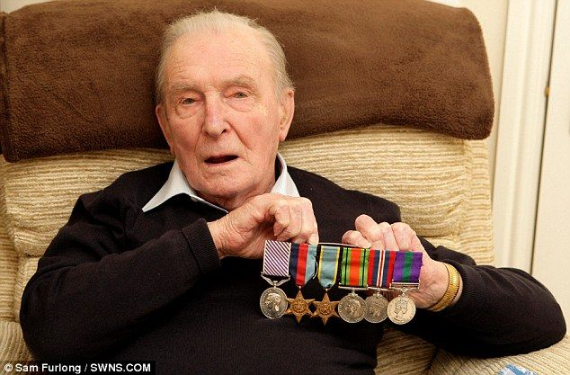 The last Dambuster: Squadron Leader Johnny Johnson, 91, at home in Bristol with his many medals