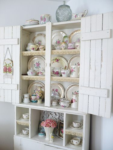 Pretty china and love the cupboard.
