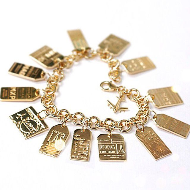 ✈ Luggage tag charm bracelet from Jet Set Candy. Each silver or gold tag features a different three-letter airport code and represents a different destination allowing you to collect your adventures one at a time ✈
