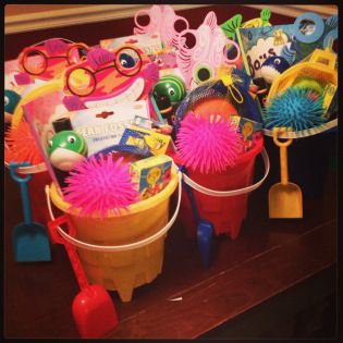 Decorate. | Under the sea party.  Party favor buckets via antersandoctopus.wordpress.com  Bucket, shovel, coloring book, crayons, mini sea life puzzle, spiky ball, fish squirter, ocean fossil kit, sand sifters and fish mask