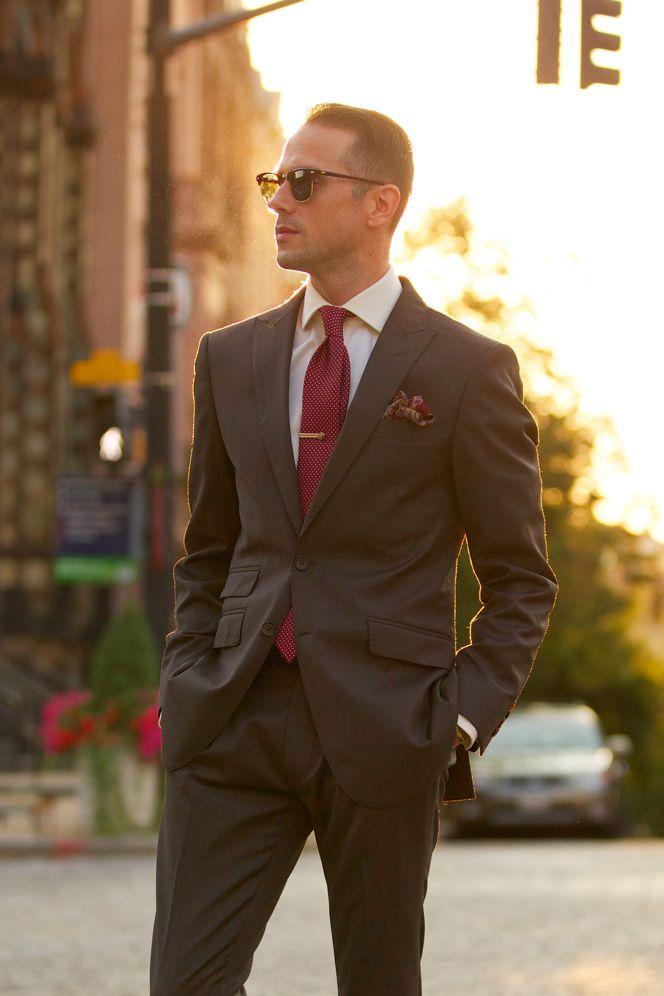 medium brown suit, paisley pocket square, polka dot tie, perfect