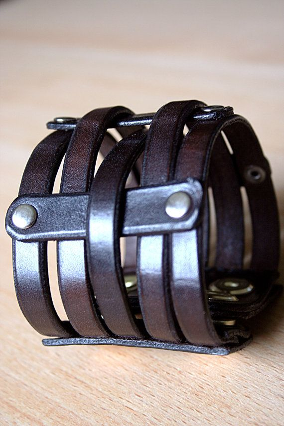 These hand crafted strap style leather bracelets are made out of quality veg tanned leather. Each one measures 2 1/4 inches wide. The length is