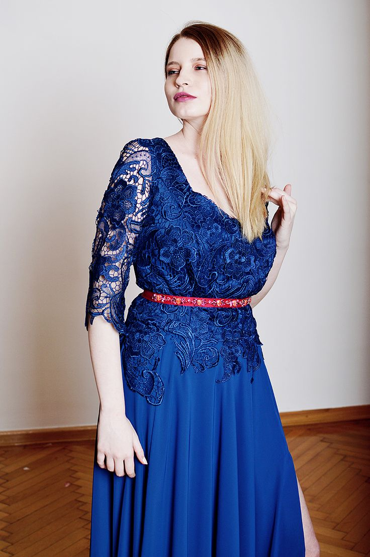 NAY is a long, navy blue, crochet lace, chiffon dress. The dress has a tight fit and a slit on the left leg. The Josephine waistband is NOT included.