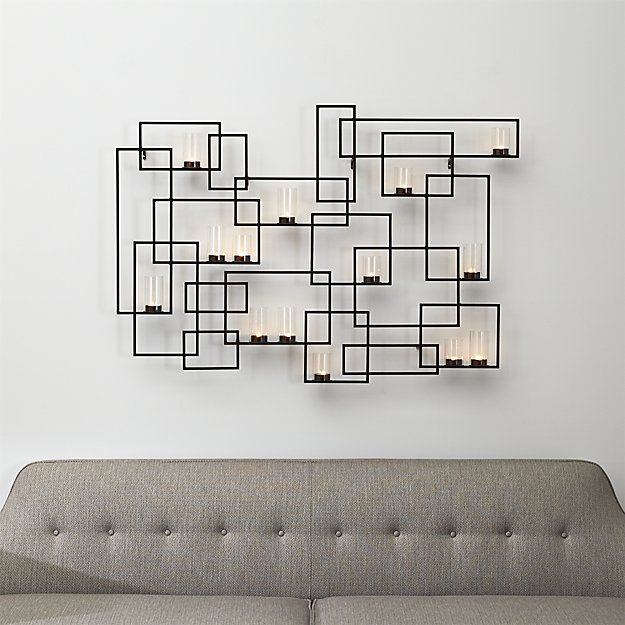 Shop Circuit Metal Wall Candle Holder.  Abstract geometrics form a mural of candlelight.  Candleplates hold eight tall and six short glass votives that accommodate cupped tea lights.