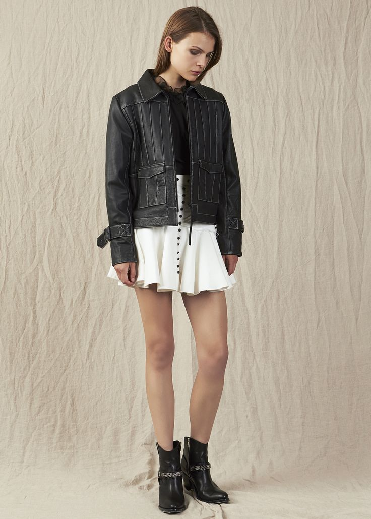 Black leather jacket with buckle embelishment white button down skirt and ankel boots. Model - Charlotte @ IMG Beauty - Isabella Schimid @ Union Management Photographer - John Rintoul. #AjeTheLabel #Aje #Fashion #Style #LookBook #AW17 #Autumn #Winter #2017 #AustralianFashion #Designer