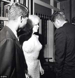 Costly affair: A rare image of Marilyn with President John F. Kennedy (right) and his brother Robert F. Kennedy together after JFKs 19 May 1962 birthday party by maria.t.rogers