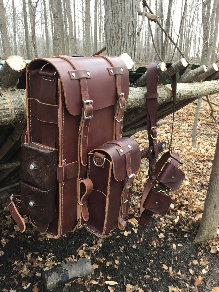 Leather bush craft day pack made from 9/10oz Latigo. Entire pack is handmade / hand stitched. The Sam Browne belt kit, knife sheath and pouches are all made by Gillie Leather.   Vintage Swiss Army Pouch on pack I did not make.   #bushcraft