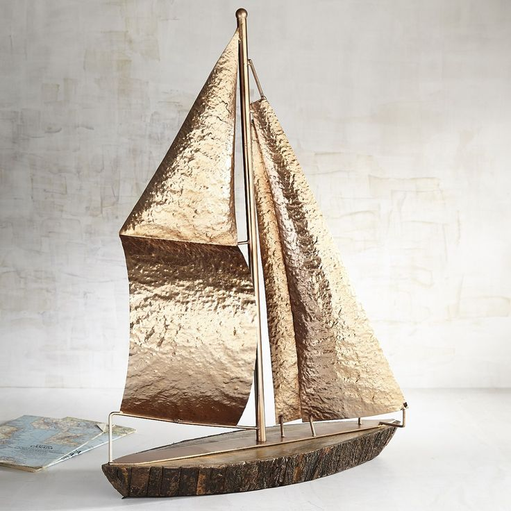 This beauty is ready to make its maiden voyage into your office, living room or vacation home. Sharing your traveler's spirit, our handcrafted sailboat is perfect as the centerpiece of your nautical theme. All aboard!