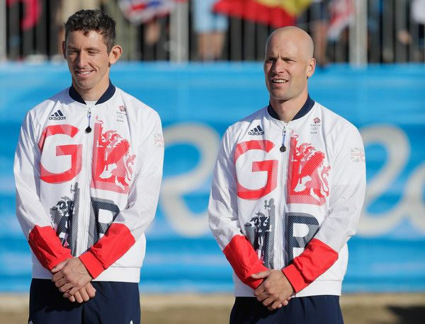 Silver medalists David Florence and Richard Hounslow of Great Britain celebrate on the podium at the medal ceremony for the Men's Canoe Double (C2) on Day 6 of the Rio 2016 Olympics at Whitewater Stadium on August 11, 2016 in Rio de Janeiro, Brazil.