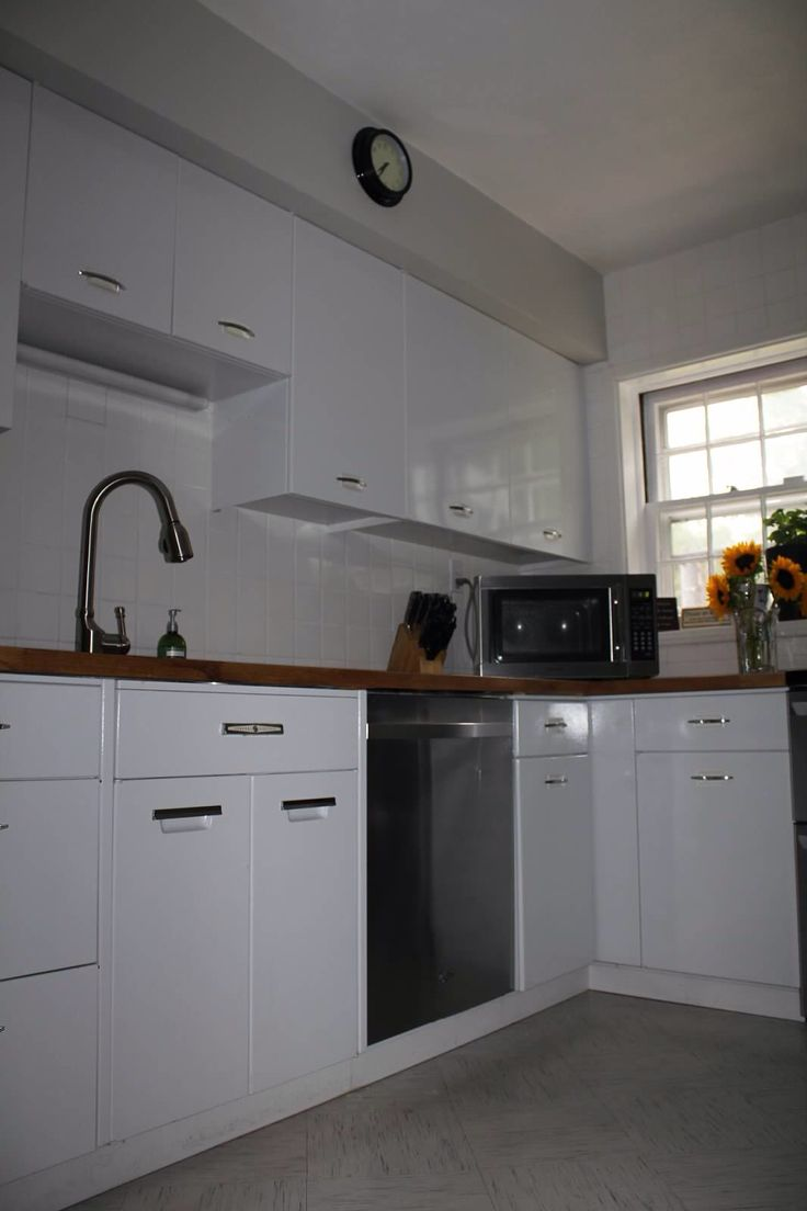 Geneva metal kitchen cabinets. Cabinet color is Benjamin Moore Pearl river.  Wall color is
