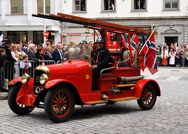 This shot is from 2014 parade on Norway`s Constitution Day or National Day, 17 May. The Fire Brigade are always represented here. Bergen have a great collection of old fire engines and a lot of other equipment. Enthusiasts in Bergen Fire Brigade Historical Society is working to establish a fire museum in Bergen's old main fire station. This old fire truck is a French built Delahaye from the beginning of the 1920s.