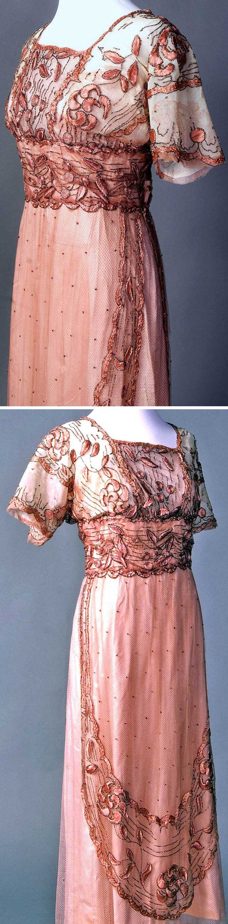 Evening dress, French, ca. 1911-15. Silk embroidery floss on silk net. Bodice, lined with lightly boned taffeta, has sleeves cut in T-shape, kimono style. Gunmetal bead trim, attached in the Luneville or tambour method. Smith College Historic Clothing