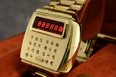 Vintage solid gold calculator watch...How can I live without this???