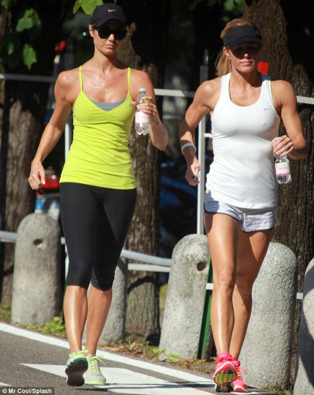 Athletic friends: Stacy Keibler and Torrie Wilson went for a run around Laglio in Italy today