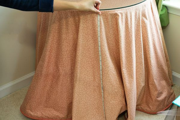 You can make a tulle table skirt to decorate a plain table for a birthday party or other special event. The table skirt resembles a ballerina's tutu and can be made from a single color of tulle or you can make a pattern of tulle ribbon around the table from different colored or patterned strips. Keep the skirt attached to the table with a piece of...