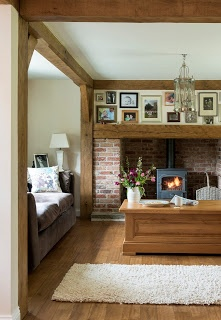 Love the fireplace  the beams - light yet cosy.