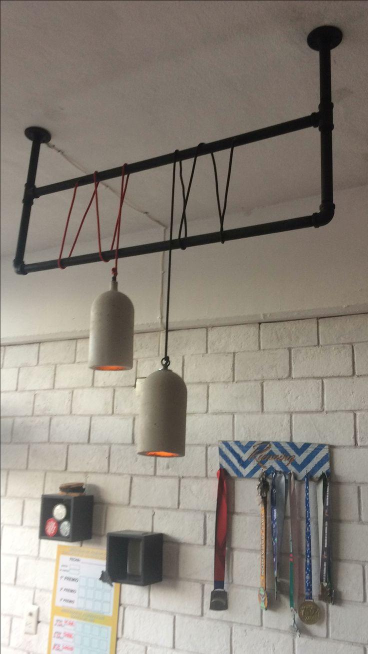 Lámparas colgantes de concreto. Proyecto: The Legend, Barbershop