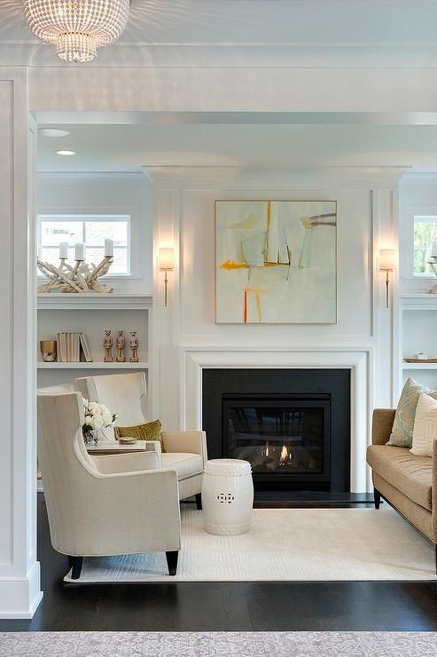 Color palette; sconces & beautiful art above simple mantle
