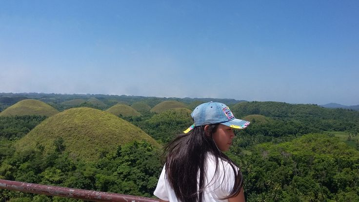 My sister admiring the beautiful view of The Chocolate Hills, a hotspot for tourists to enjoy.