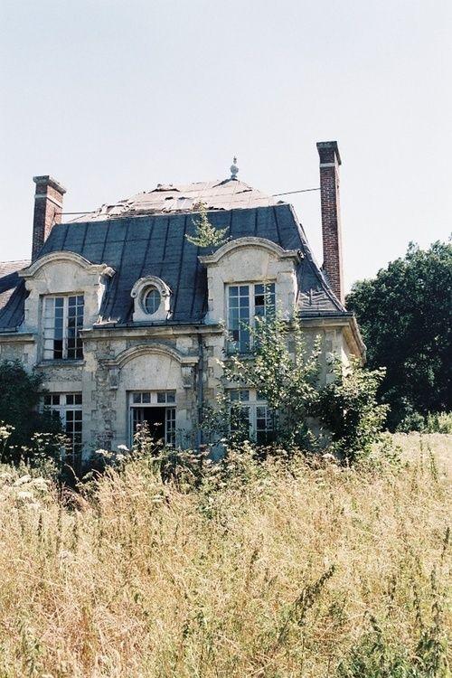 abandoned french style house